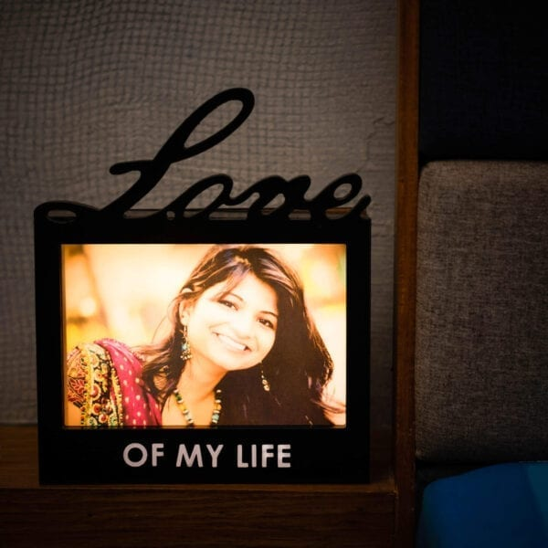 love cutout photo frame in wood with light